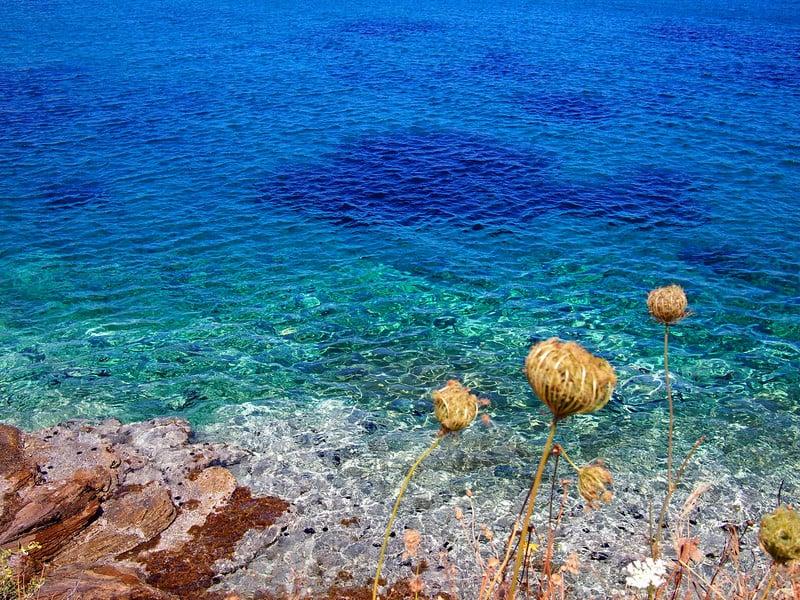 Beautiful crystal clear waters in Poseidonia Syros, Greece.