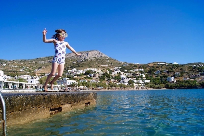 4 reasons why greece is the best holiday for kids child jumping in to the