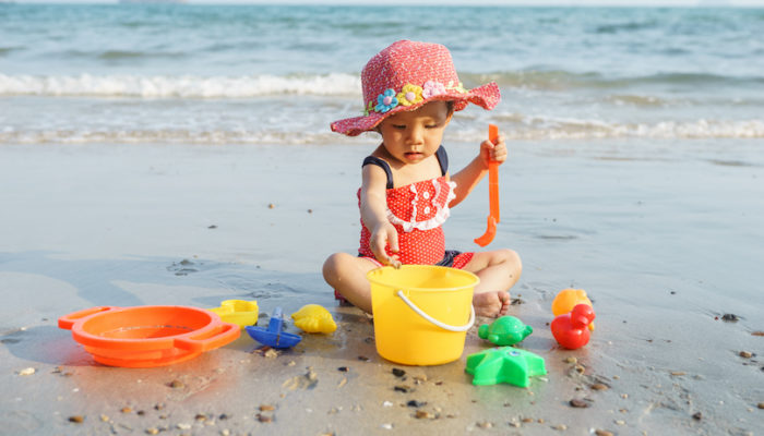 What's the Best Greek Island for Family Holidays? - Little girl playing on the beach.