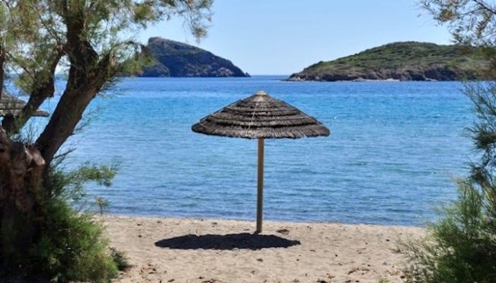 Image of beautiful romantic beach on Syros- the best greek island for couples.
