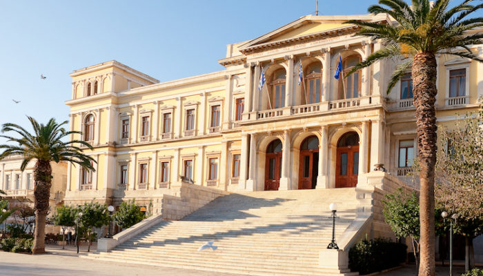 The beautiful neoclassical building of the Town Hall in Syros. Cycladic Architecture.