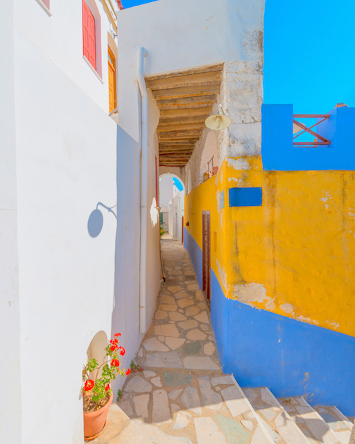 Beautiful alley on Syros island in Greece. The perfect destination for eco-holidays.